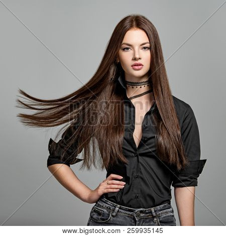 poster of Young woman with long straight hair - at studio. Portrait of an attractive brunette girl. Fashion mo