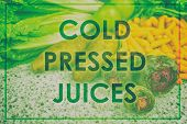 Juice text as title on poster. Words COLD PRESSED JUICES for advertising sign over picture of fresh  poster