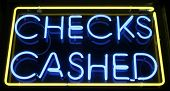 "stock photo of loan-shark  - ""neon sign"" series ""checks cashed"" - JPG"