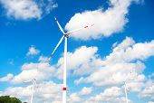 Turbine Or Windmill Blue Sky Background. Alternative Energy Source. Go Green Eco Friendly Technology poster