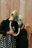 foto of poka dot  - two young women wear gas masks connected to each other for a uniqe photograph - JPG