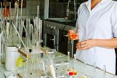 A Female Laboratory Assistant, A Doctor, A Chemist, Works With Flasks, Test Tubes, Makes Solutions,  poster