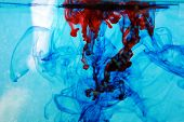 image of early 60s  - red and blue food coloring floats freely in a tank of clean clear water in a psychedelic pattern that is reminiscent of the early 1970 - JPG