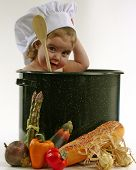 image of yoke  - baby girl in a chef pot - JPG