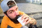 Urban Food Culture Concept. Tasty Sip Concept. Tasty Coffee Tea In Paper Cup Close Up. Man Bearded H poster