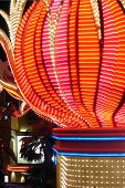 stock photo of las vegas casino  - The colorful lights of the Flamingo Hotel - JPG