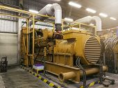 A Very Large Electric Diesel Generator In Factory For Emergency,equipment Plant Modern Technology In poster