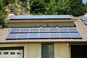 alternative energy photovoltaic solar panels on the roof of a home. collecting energy from the sun a