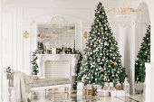 Gifts At The Christmas Tree. Christmas Morning. Classic Luxurious Apartments With A White Fireplace, poster