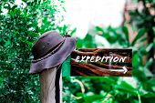 An Expedition Sign / Icon Which Points The Way Into The Nature. poster