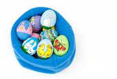 stock photo of duck egg blue  - Colorful hand painted Easter eggs with delightful animal figures nested in blue fleece - JPG