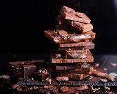 Assorted Stack Chocolate Candies. Chocolate Sweets. Candy Design Over Dark Brown Background. Various poster