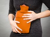 Unrecognizable Woman Having Strong Stomach Ache. Female Suffer On Belly Pain, Holding Hot Red Water  poster