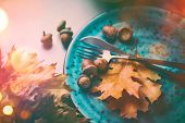 Thanksgiving Dinner. Thanksgiving wooden table served, decorated with bright autumn leaves. Holiday  poster