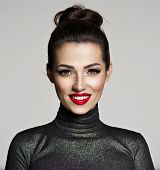 Beautiful young smiling woman with red lipstick. Glamour fashion model with bright gloss make-up  po poster