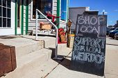 Shop local saturday, support your local weirdos, humorous sign written in chalk, supporting small lo poster
