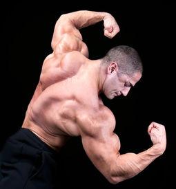 foto of body builder  - Back view of a body builder - JPG