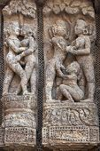 foto of surya  - Detail of erotic carvings decorating the ancient Surya Hindu Temple at Konark Orissa India. 13th Century AD ** Note: Slight blurriness, best at smaller sizes - JPG