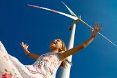 image of dynamo  - child playing with the wind near a turbine - JPG