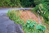 image of landslide  - Danger landslide on the bend of asphalt road - JPG