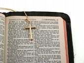 foto of atonement  - gold cross on portion of kjv bible opened to i corinthians 15 - JPG