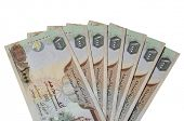 image of dirhams  - Many One Thousand UAE Dirhams currency notes - JPG