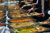 pic of catering  - people group catering buffet food indoor in luxury restaurant with meat colorful fruits  and vegetables - JPG
