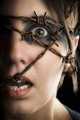 image of dread head  - Terrified woman with barbed wire around the head - JPG