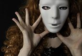 pic of chokers  - Woman with long curly red hair wearing white mask - JPG