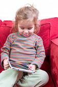 Adorable Shy Little Girl With A Tablet-pc