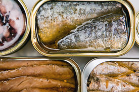 pic of hermetic  - Tin cans of aluminum of different size of sardines, mackerel in olive oil