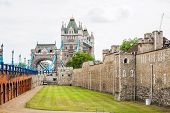 picture of fortified wall  - View of wall the Tower of London with Tower Bridge in the background - JPG