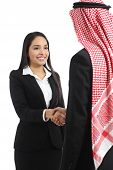 image of arabic woman  - Arab saudi business man and woman handshaking isolated on a white background - JPG