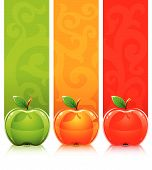 Three Coloured Apples On Decorative Background