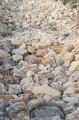 picture of ravines  - Full frame take of boulders in the bed of a ravine - JPG