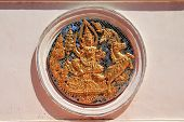 pic of surya  - statue of Surya in a thai architectural  - JPG