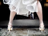 foto of stocking-foot  - feet of bride dress with heels and flight - JPG