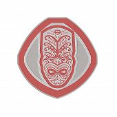 stock photo of maori  - Metallic styled illustration of a traditional maori mask face facing front set inside shield done in retro style on isolated background - JPG
