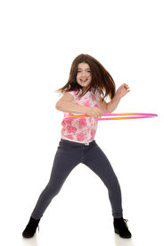 pic of hulahoop  - child doing hula hoop with motion blur on white background - JPG