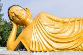 image of recliner  - Reclining golden Buddha statue at Srisoonthorm temple Phuket - JPG