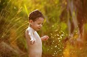 image of beatitudes  - Little boy in the summer of splashing water - JPG