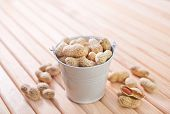 Постер, плакат: raw peanuts in shell