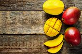 picture of mango  - mango on a dark wood background - JPG