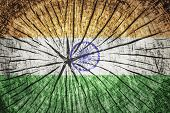stock photo of gandhi  - Flag of India on cracked wooden texture - JPG