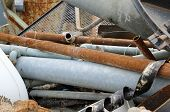 picture of landfill  - rusted iron pipes of a landfill of ferrous material - JPG