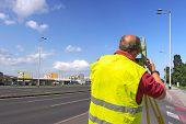 stock photo of theodolite  - Surveyor engineer worker making measuring with theodolite equipment - JPG