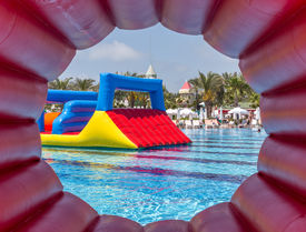 pic of inflatable slide  - Inflatable slide in a nice pool for children - JPG