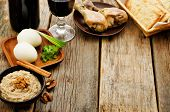 picture of matzah  - Matzah wine eggs chicken greens and haroset on a dark wood background traditional food for the Pesach - JPG