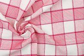 image of twist  - closeup of twisted kitchen napkin for backgrounds - JPG