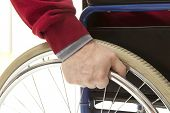 foto of wheelchair  - Wheelchair user makes various movements with his wheelchair - JPG